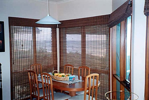 bamboo-roller-blinds--installed-into-bay-windows